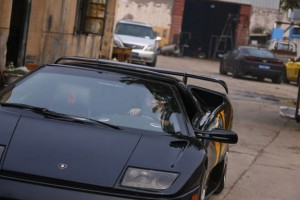 Wang drives a handmade replica of Lamborghini Diablo during a test drive outside a garage on the outskirts of Beijing