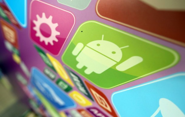 A logo for Google Inc.'s Android operating system is displayed on an advertising sign during the Apps World Multi-Platform Developer Show in London, U.K., on Wednesday, Oct. 23, 2013. Retail sales of Internet-connected wearable devices, including watches and eyeglasses, will reach $19 billion by 2018, compared with $1.4 billion this year, Juniper Research said in an Oct. 15 report. Photographer: Chris Ratcliffe/Bloomberg via Getty Images